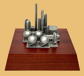Oil and gas refinery model mounted on base for custom logo engraving