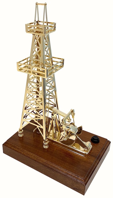 Gold plated oil well pump with derrick battery powered